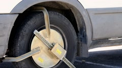 Police anti-theft device on the wheel of the car Stock Footage