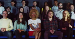 4K Young theatre audience give a standing ovation to the performers on stage - stock footage