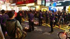 Team with glowing drums at new year parade, showing performance on street Stock Footage