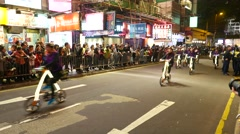 Bicycle team on the parade show, tracking asian woman on bike Stock Footage