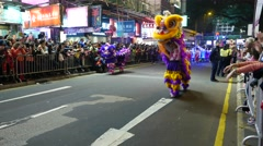 Man with chinese dragon mask walking on parade, ny selebration Stock Footage