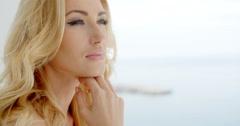 Beautiful woman recalling memories at the seaside Stock Footage