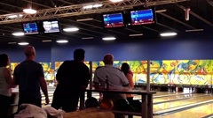 People play bowling in the playing hall - stock footage