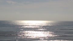 Sparkling wavy sea water is shining on a misty morning Stock Footage