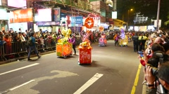 Candy booth carts on parade, Chinese New Year celebration Stock Footage