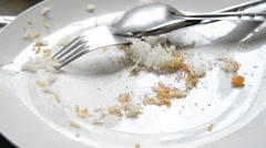 Ants eating food scraps on white plate Stock Footage