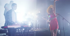 4K Beautiful charismatic female singer performing with band at live music event Stock Footage