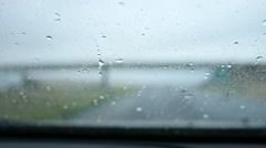 POV of car driving in the rain, wet windscreen Stock Footage