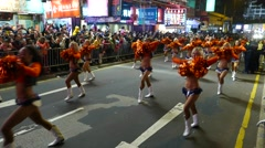 Cheer-leading show on night festival procession Stock Footage