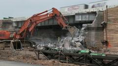 Jack-hammer deconstructs highway bridge abutment Stock Footage