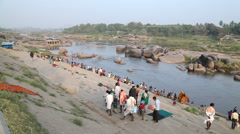 People on the Tungabhadra river in Hampi. Stock Footage