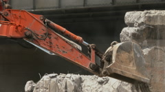 Jack-hammer demolishes concrete as back hoe collects pieces Stock Footage