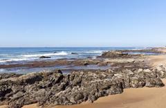 Rocks Exposed at Low Tide, Umdloti Beach Durban South Africa Stock Photos