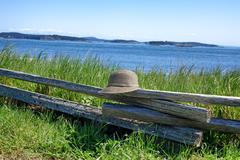 Stock Photo of Split Rail Fence with Hat on water front