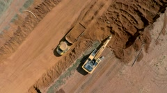 Aerial view excavator scoop loads a dump truck Stock Footage