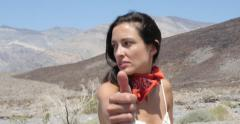 Female Hitchhiker in Death Valley Desert Stock Video - stock footage