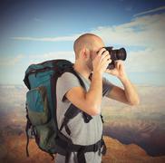 Explorer photographing landscapes Stock Photos