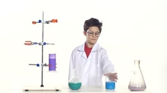 Young boy chemist wearing uniform, red shirt and round glasses in laboratory Stock Footage