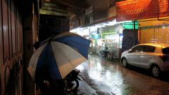Rainy season downpour in Medan city streets - stock footage