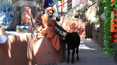 Indian sadhu, holy man in street near river Ganga. Devprayag Stock Footage