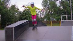 Portrait of a sportive child inline skates blading Stock Footage