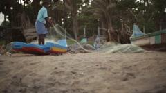 Fisherman organizing fishing net in India 3 - stock footage