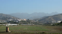 Overview of fields, village and mountains in a typical andalusian village Stock Footage
