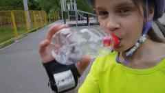 Portrait of sports child drinking water Stock Footage