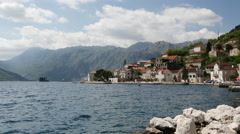 The artificial island Gospa od Škrpjela and the town Perast Stock Footage