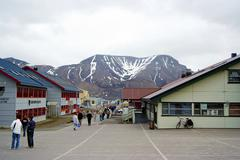 Street with houses in  Spitsbergen, Svalbard, Norwaw on a cloudy day. - stock photo