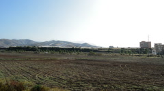 Overview of fields, village and mountains in a typical andalusian village - stock footage