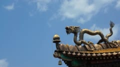 Stock Video Footage of time lapse:  gold dragon on the eave,  clouds moving