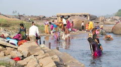 People having bath on the Tungabhadra river in Hampi. Stock Footage
