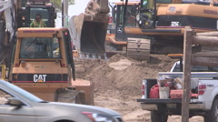 Road construction in the summer for new road and transit line. Stock Footage