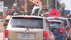Road construction in the summer for new road and transit line. - stock footage