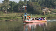 Driving boat with pilgrims on the Tungabhadra river. Stock Footage