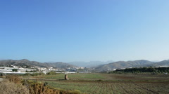 Fields, village and mountains in a typical Andalusian village a sunny day Stock Footage