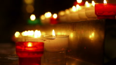 Illuminated candles in Church of Saint Marie - Madeleine - stock footage
