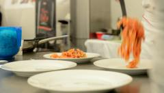 Chef prepares food - tomato and spinach pasta Stock Footage