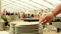 Detail of white plate - restaurant with people on exhibition in background-chef Stock Footage