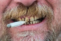 Man smoking a cigarette Stock Photos