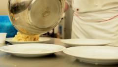 Chef prepares food - pasta - serve on plate Stock Footage