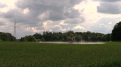 Tractor spray crop field with sprayer pesticide. Village work Stock Footage