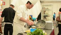 Chef prepared food (meal: pasta with meat) - cook prepares pancake in background Stock Footage