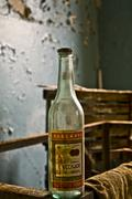 inside the Abandoned Soviet canteen empty bottle of russian vodka - stock photo