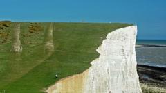 Man walking in Seven Sister chalk cliffs, Brighton, London. United Kingdom - stock footage