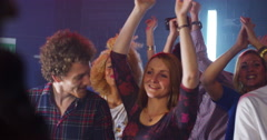 4K Young crowd dancing and having a great time at live music event - stock footage