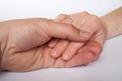 United hands on white background - stock photo