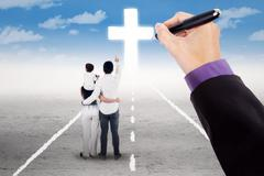 Stock Photo of Family guided to follow a cross