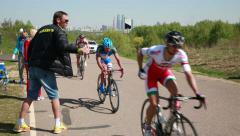 Bicycle Race. The staff and coaches give athletes a water bottle during the race - stock footage